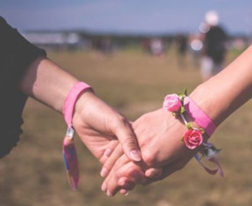 Photo of two ladies holding hands each other
